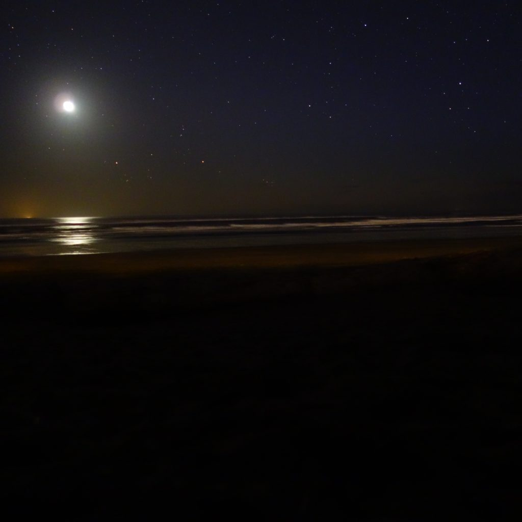 Moon over Pacific Ocean at Rockaway Beach, Oregon